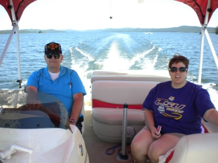 On my parents' boat in Arkansas. Notice the T-shirt I'm wearing, though!