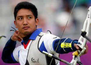 Japan's Yu Ishizu takes aim during the men's archery team eliminations at the Lords Cricket Ground during the London 2012 Olympics Games